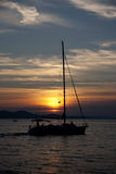 Boat on a sunset. People on the boat Stock Photos