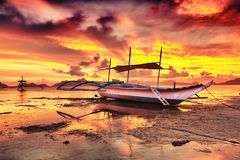 Boat at sunset Stock Image