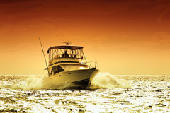 Boat and sunset Stock Photography