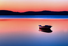 Boat in sunset Stock Photos
