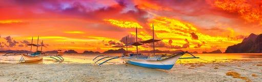 Boat at sunset. Traditional philippine boat bangka at sunset time royalty free stock photos