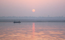 Boat at the sunset. Holy river of Ganga in Varanasi, Uttar Pradesh, India Royalty Free Stock Photography