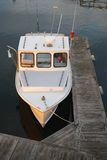 Boat at sunset. Boat tied up to the dock Royalty Free Stock Photography