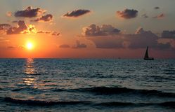 Boat at Sunset. A boat sailing at sunset at Apolonia Beach in Israel stock images