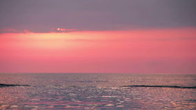 Boat on Sunset Background Floating on the Sea. Background red sky after sunset. Full HD 1920 x 1080, 29,97fps stock video footage