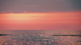 Boat on Sunset Background Floating on the Sea stock video footage