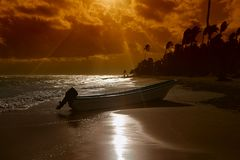 Boat and sunset beach Royalty Free Stock Image