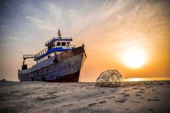 Boat at sunset. A boat on the beach of Ajman during the sunset royalty free stock images