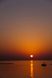 Boat , sunset at beach in Cyprus Royalty Free Stock Photo