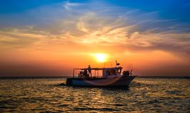 Boat at sunset. With beautiful sky Stock Photos