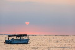 Boat at Sunset. A boat and a sunset from the beach in Hawaii stock photos