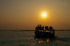 Boat with passengers at the sunset Royalty Free Stock Photo