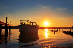 Boat at sunset. Boat caressed by the rays of the setting sun Royalty Free Stock Photography