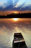 Boat and sunset glow Royalty Free Stock Photo