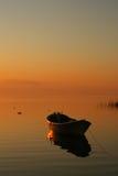 Boat at sunset. Golden glow boat on lake iznik, turkey royalty free stock photography
