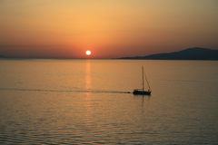 A Boat at the sunset Royalty Free Stock Images