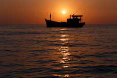 Boat on sunset Stock Images