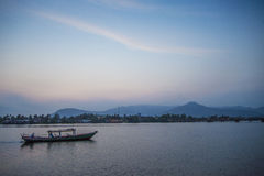Boat at sunset in kampot riverside cambodia Royalty Free Stock Images