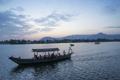 Boat at sunset in kampot cambodia Royalty Free Stock Photos