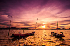 Boat in the sunset. Longtail boat in the sea with sunset sky royalty free stock photo