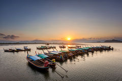 Boat sunset mountain Stock Photos