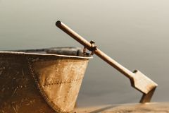 Boat at sunset boat with oars. Stock Photos
