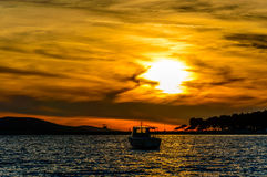 Boat at sunset. Boat at sea in sunset at cove on island Bra Stock Images