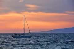 Boat on sunset sea Royalty Free Stock Photos