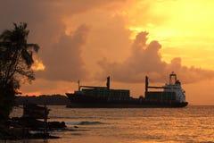 Boat on sunset sea Stock Photography