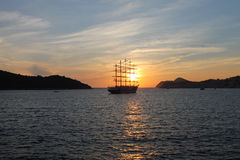 Boat in sunset. Ship and sunset at sea Stock Image