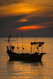 A boat in sunset. A silhoutte boat taken during sunset in Penang sea royalty free stock photography