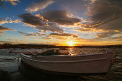 Boat at sunset. Boat in a small bay at sunset Royalty Free Stock Photo