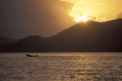 Boat at sunset. In Trinidad, West Indies Royalty Free Stock Photos
