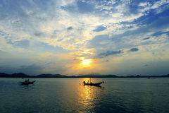 Boat with sunset. Tropica sunset, and silhouette boat on the beach Thailand Stock Photos