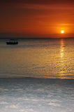 Boat in the sunset - Zanzibar. Boat in the sunset in Zanzibar (Tanzania) with a special colorful sunset and white sand stock image
