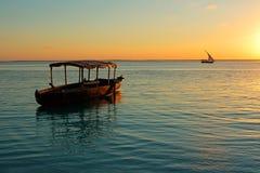 Boat at sunset - Zanzibar Stock Photos