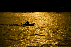 Boat on sunshine. Small boat on sunshine in the evening Royalty Free Stock Photo