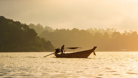 Boat on sunshine in lake. The boat working in morning in lake,beautiful in nature Stock Photo