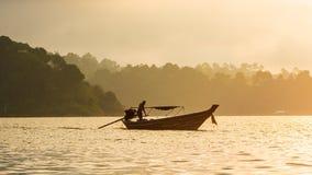 Boat on sunshine in lake Stock Photo