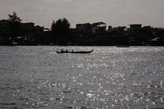 Boat in the sunshine on the Tonle Sap lake Stock Images