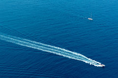Boat surf foam aerial from prop wash in blue sea Stock Images