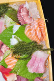 A boat of sushi with tuna, salmon, green caviar and octopus Royalty Free Stock Photography