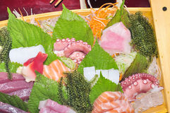 A boat of sushi with tuna, salmon, green caviar and octopus Stock Photo