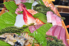 A boat of sushi with tuna, salmon, green caviar and octopus Royalty Free Stock Image