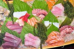 A boat of sushi with tuna, salmon, green caviar and octopus Royalty Free Stock Photo