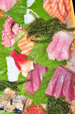 A boat of sushi with tuna, salmon, green caviar and octopus Stock Photography