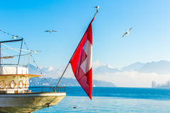 Boat with Swiss Flag on Lucerne, Switzerland Royalty Free Stock Photography