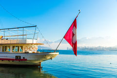 Boat with Swiss Flag on Lucerne, Switzerland Royalty Free Stock Images