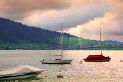 Boat on Swiss Lake, Zug, Switzerland. A pastel sunset lake after the rain Royalty Free Stock Photo