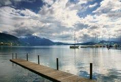 Boat on Swiss Lake, Zug, Switzerland. STILL sunset lake after rain Royalty Free Stock Photos